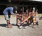 Boys working on furniture for the Kiboko Lodge